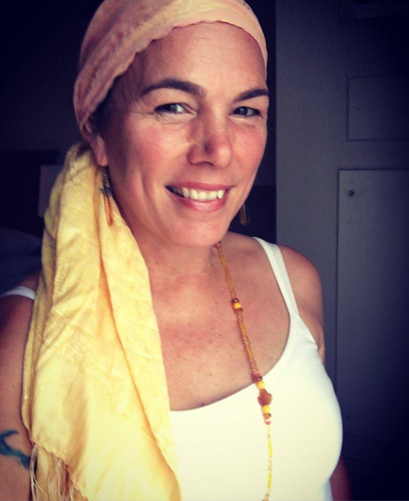 Lucumi practitioner wearing yellow.